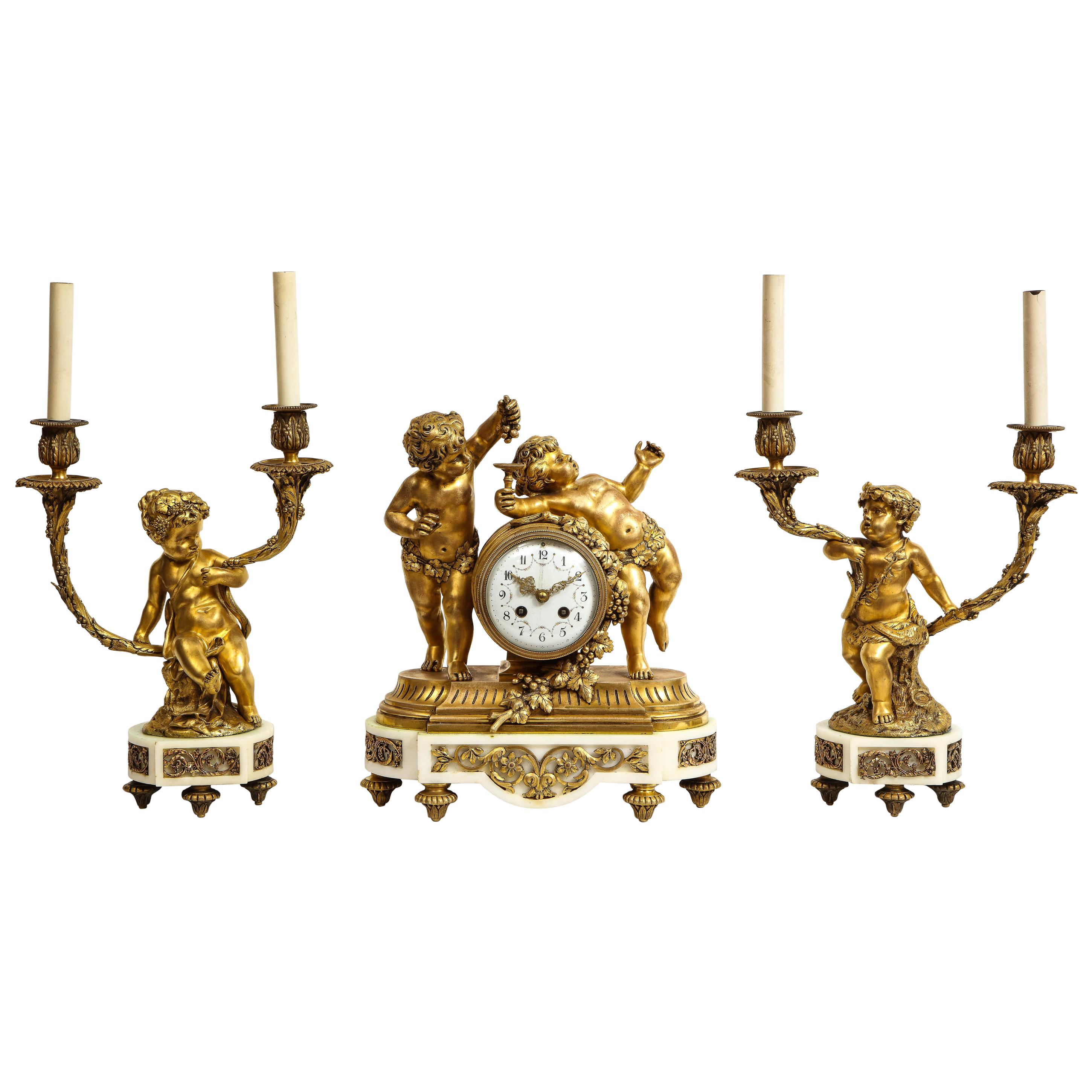 French Ormolu-Mounted White Marble Three Piece Clock Garniture, Clodion
