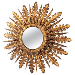 French Oversized Backlit Sunburst Mirror in Gilt Iron with Foliate Details