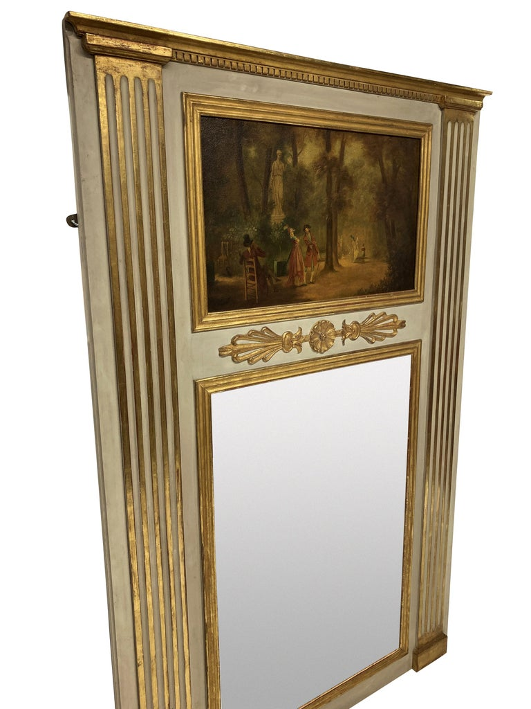 A French and gilded trumeau mirror, with putty colour paints, water gilding and an oil painting on panel depicting an XVIII century romantic woodland scene. Label verso.