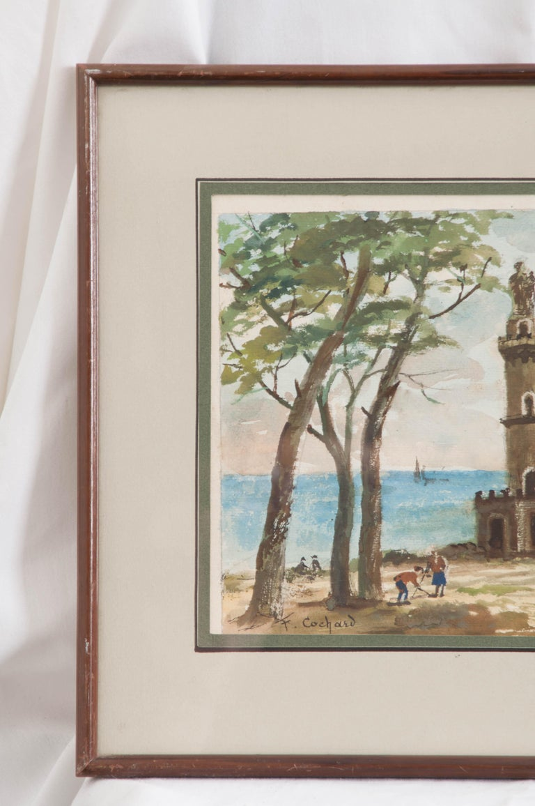 Tranquil painting of French seaside with a castle-like folly topped with a statue is framed in distressed wood and signed by the artist, F. Cochard.