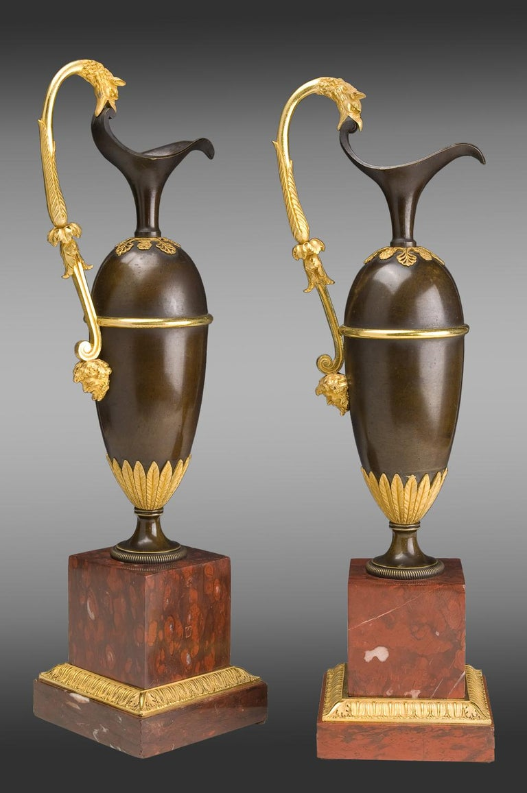 French pair of Jars in gilded and patinated bronze on a marble base red Campan Model of A. Ravrio, Early 19th century.
