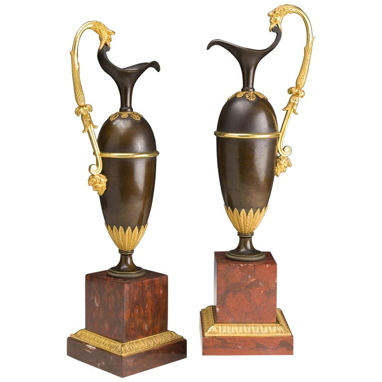 French Pair of Jars in Gilded and Patinated Bronze on a Marble Base Red Campan For Sale