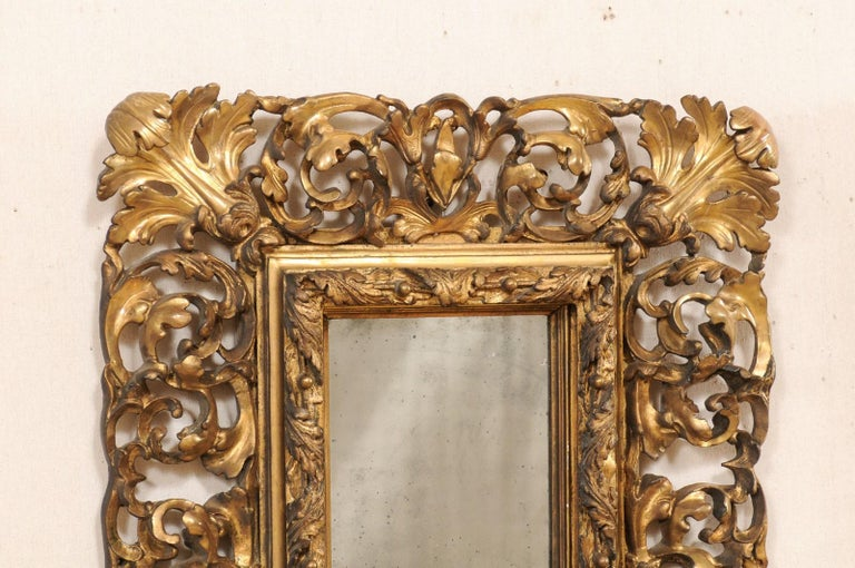French Pair of Ornately Pierce-Carved and Giltwood Rococo Mirrors, Early 19th Century For Sale