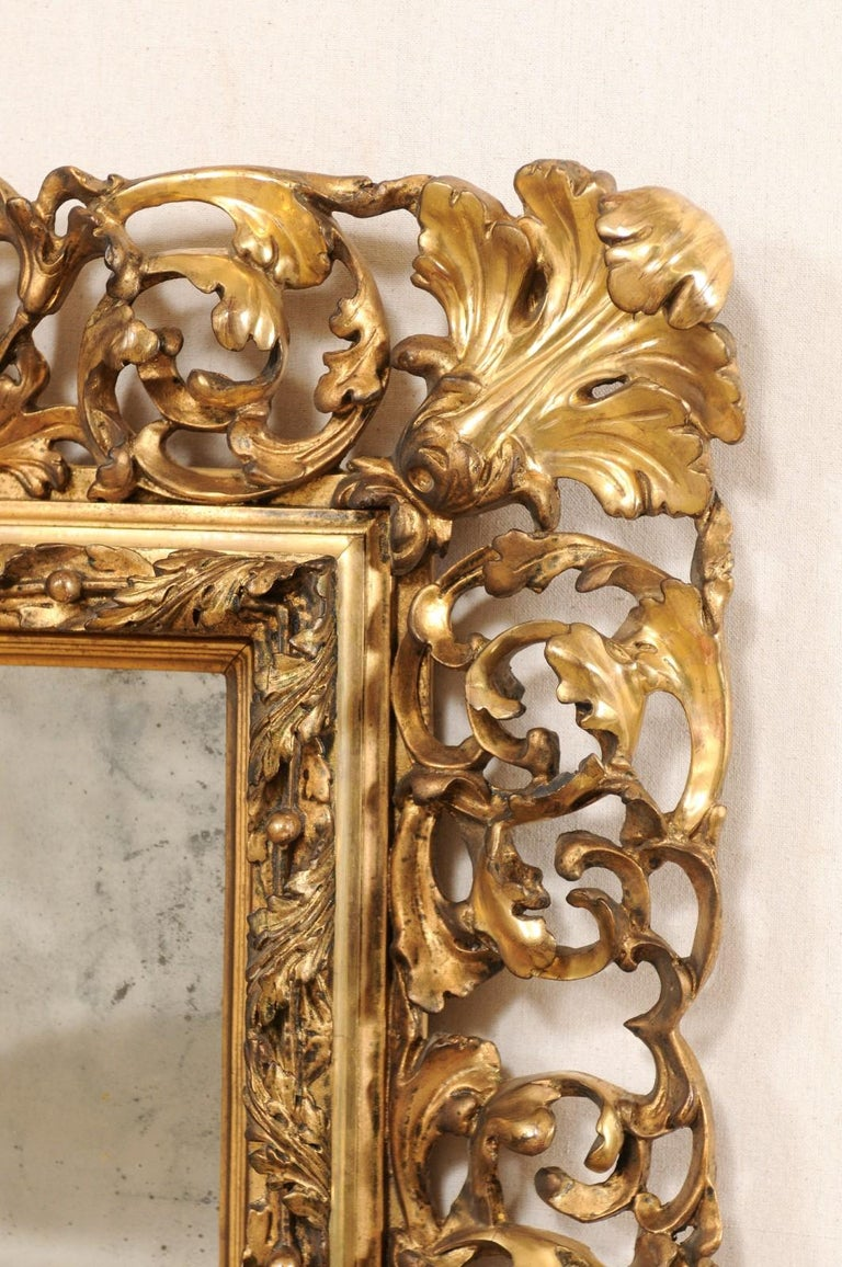 Hand-Carved Pair of Ornately Pierce-Carved and Giltwood Rococo Mirrors, Early 19th Century For Sale