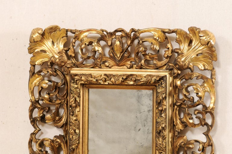 Wood Pair of Ornately Pierce-Carved and Giltwood Rococo Mirrors, Early 19th Century For Sale