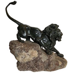 French Patinated Bronze Figure of a Lion on Rock Base