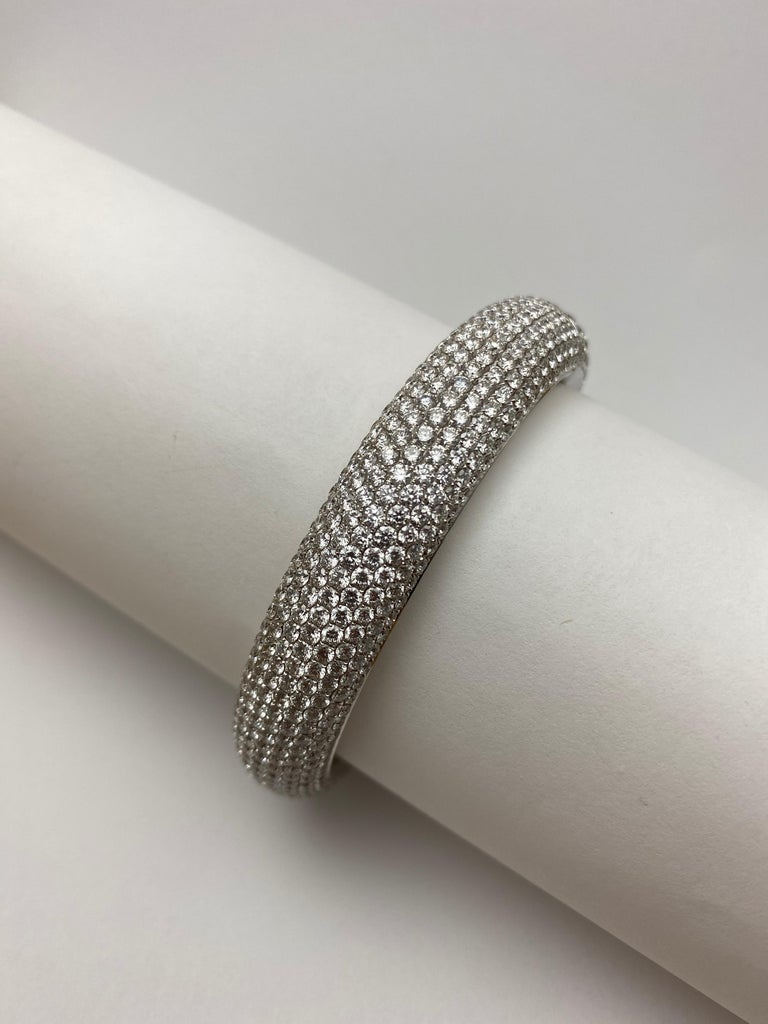 Made in France, this bangle is expertly set with over 25cts of bright, white diamonds.  It is as appropriate for an elegant event as it is for a chic soiree and this versatile jewel will bring joy to the wearer for years to come.  The unique