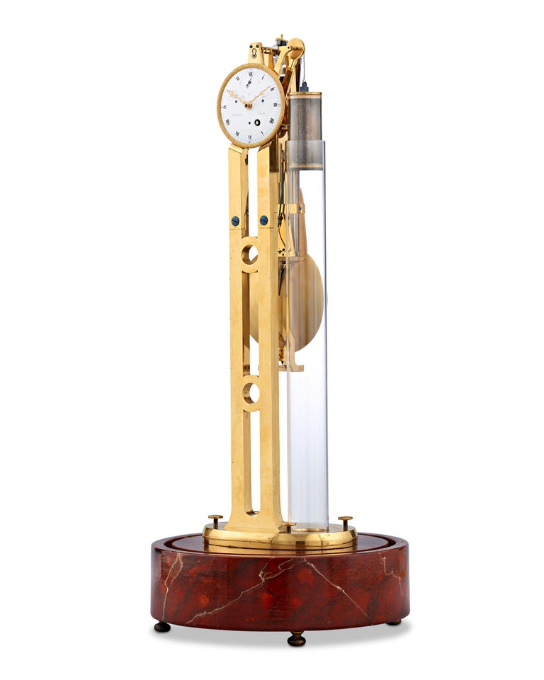 Impeccable quality and craftsmanship distinguish this extraordinary Louis XVI-era pendulum skeleton clock. Crafted from doré bronze in a towering, graceful design, the French timepiece is visually and mechanically stunning. The clock's single train