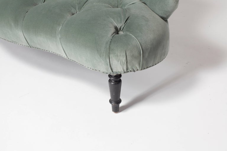 Sweet French petite tufted settee newly upholstered in beautiful blue grey velvet. Nails offer a nice