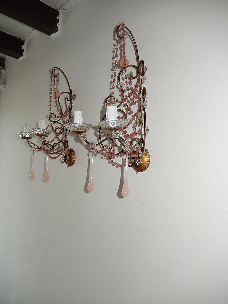 Housing 2-light, sitting in crystal bobeches. Re-wired and ready to hang! Swags of pink opaline beads and florets throughout. Adorning Murano pink opaline drops. Beads on back plate as well. Free priority shipping from Italy.