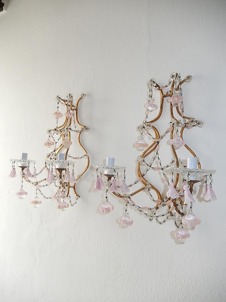 Housing 2-light, sitting in crystal bobeches, dripping in pink opaline flower bells. Gold gilt metal. Also adorning pink crystals and Murano balls with pink opaline ribbon encircling. Re-wired and ready to hang!
