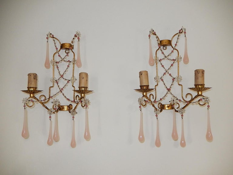 Housing 2-light, sitting in crystal bobeches. Will be re-wired with appropriate sockets for country and ready to hang! Swags of pink opaline and clear beads and star prisms. Adorning Murano pink opaline drops. Free priority UPS shipping from Italy,