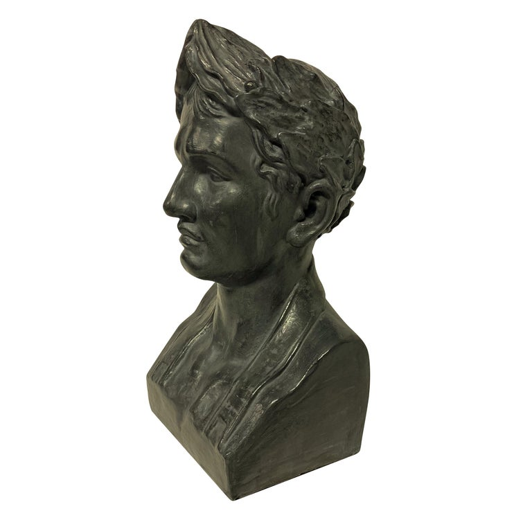 A French painted plaster bust of Napoleon as Emperor, in basalt grey.