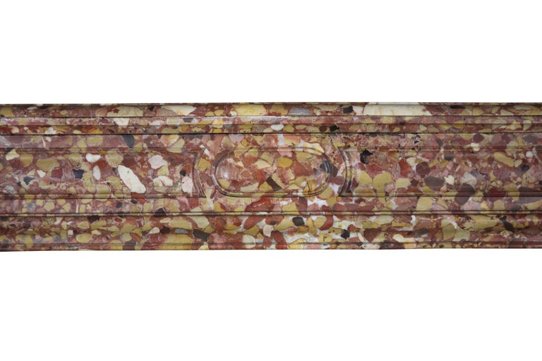 This stunning Pompadour marble fireplace mantel is made from the rich Royal colored Brêche d'Aleppe marble. It is nicely carved (see the attached photos) and has bronze air vents in its side panels. Perfect to create a French style