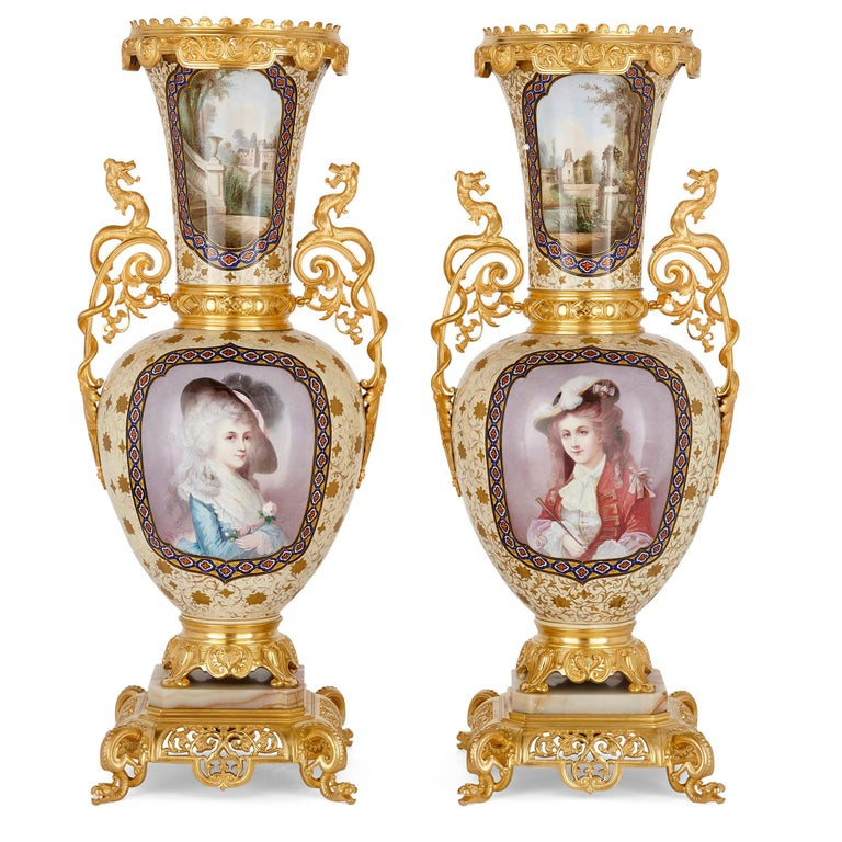 French porcelain and gilt bronze vases in the Chinoiserie style French, 19th century Measures: Height 79cm, width 33cm, depth 30cm  Crafted in the distinctive and eclectic French Chinoiserie style, this beautiful pair of gilt bronze mounted