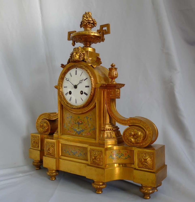 French Ormolu and porcelain mantel clock of Classical design dating from the mid-19th century stamped in the mint and original Ormolu H. Picard. Numbered in the bronze, 1297. The original ormolu is in quite pristine and totally original condition.