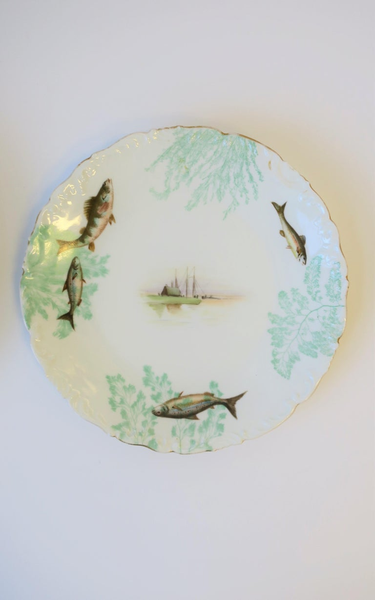 French Porcelain Limoges Plates with Fish and Boat Design For Sale 4