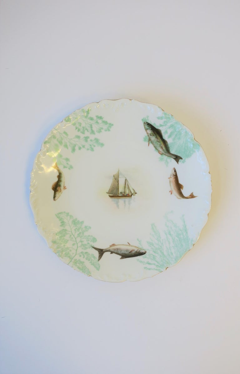 French Porcelain Limoges Plates with Fish and Boat Design For Sale 5