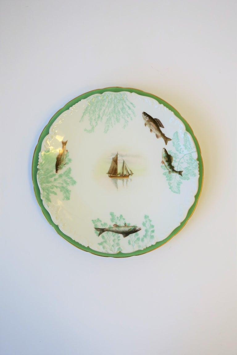 French Porcelain Limoges Plates with Fish and Boat Design For Sale 14