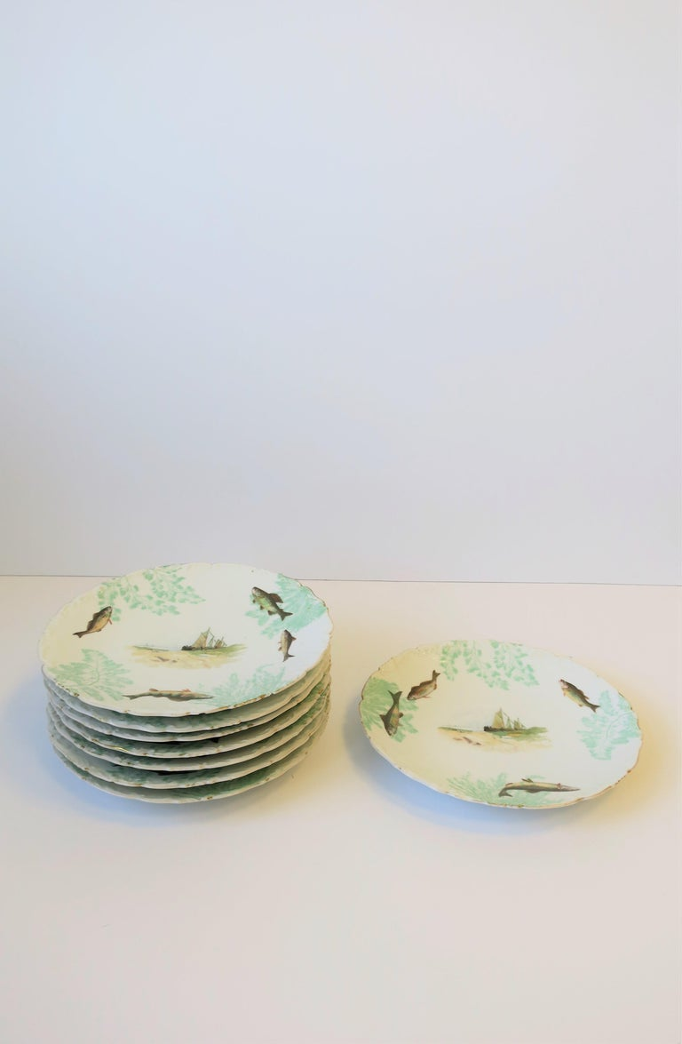 20th Century French Porcelain Limoges Plates with Fish and Boat Design For Sale