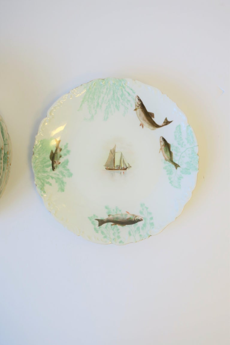 French Porcelain Limoges Plates with Fish and Boat Design For Sale 3