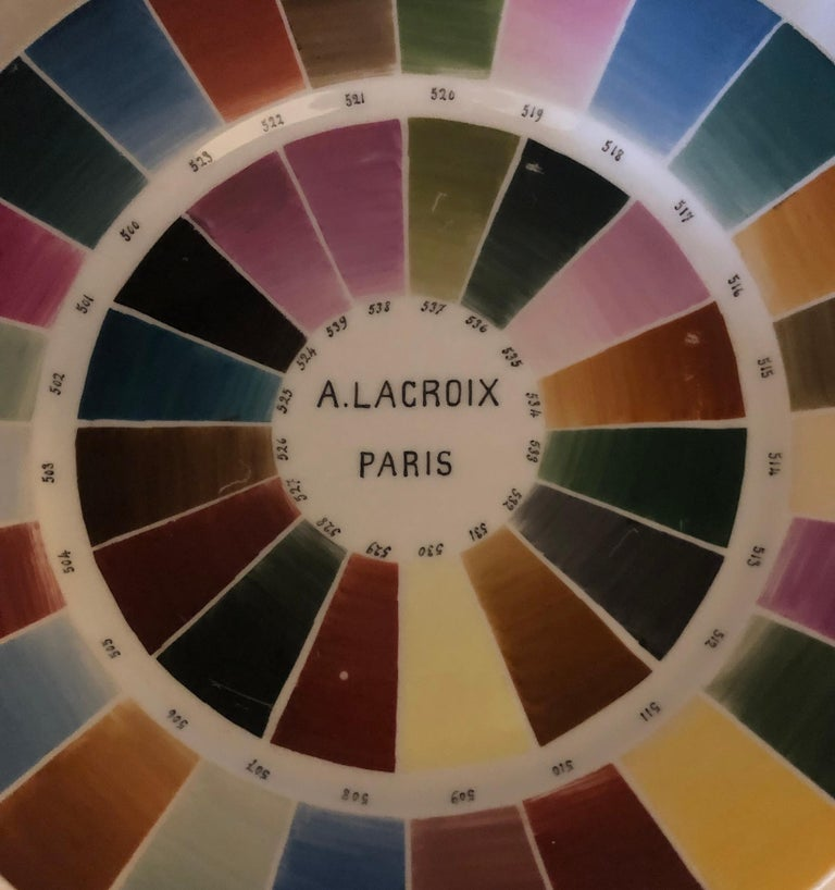 Consisting of various hand-enameled numbers over-glaze beneath tapering rectangular color tabs.