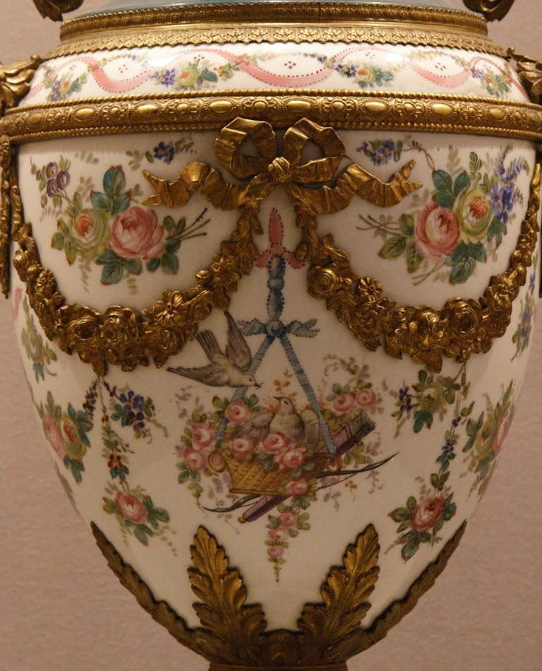 A vase in porcelain finely painted with flowers and turtle doves, garlands in bronze gilt, Louis XVI Style, circa 1890.
