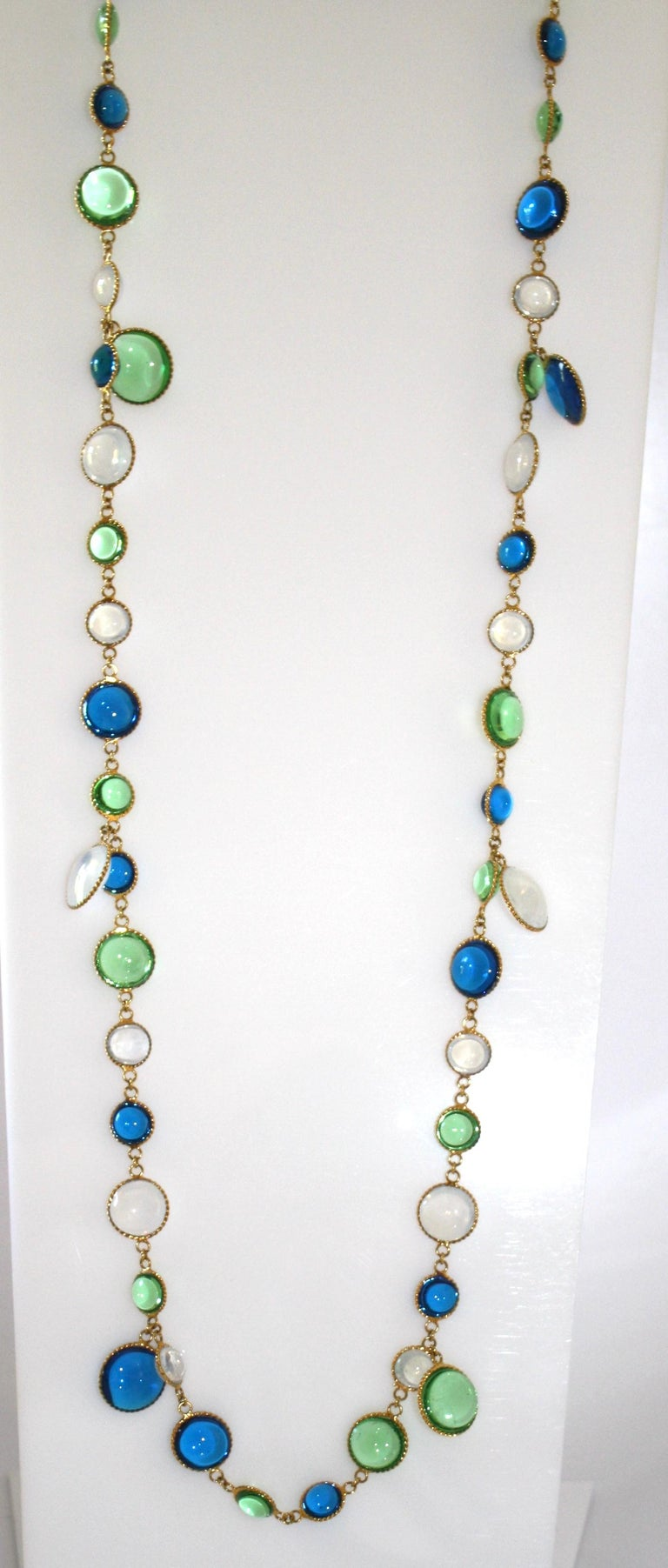 Hand poured glass necklace made in Paris, France.