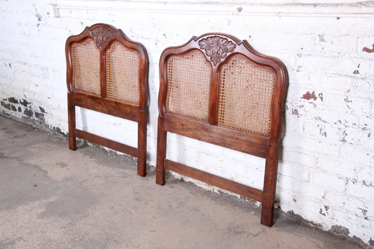 A gorgeous pair of French Country Louis XV style twin size headboards  By Hickory Manufacturing Co.  USA, 1970s  Oak and cane  Measures: 40.75