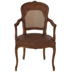 French Provincial Louis XV Style Armchair with Embossed Faux Leather Caned Back