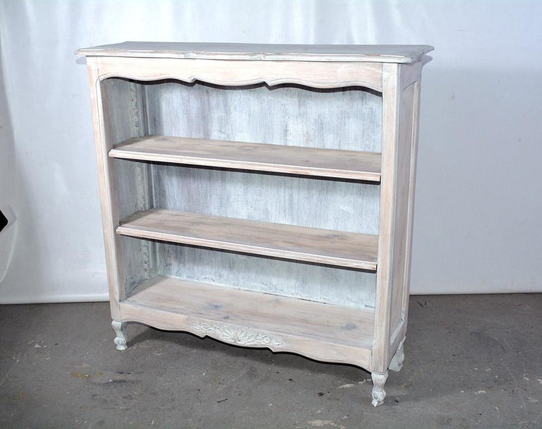 Rustic country Provincial style book case or book shelf with carved scalloped details will be useful in any room for books or displaying collectables. The shelving unit has been white washed for added charm. Perfect bookcase for a children's room.