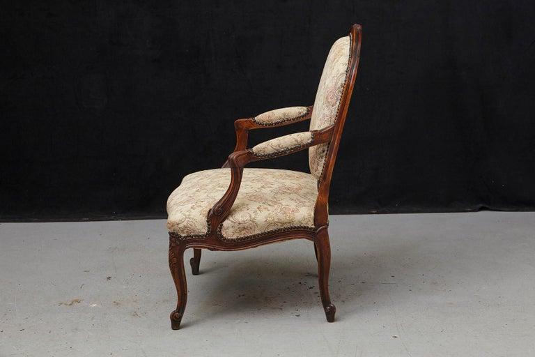 Brass French Provincial Louis XV Style Walnut Fauteuil with Nailhead Trim, circa 1930s For Sale