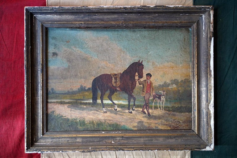 In entirely original condition, the provincial oil on canvas painting of a youth with a stallion and hunting dog amidst classic rural French countryside walking upon a track by a river side, painted in the naïve style by a journeying Englishman, and