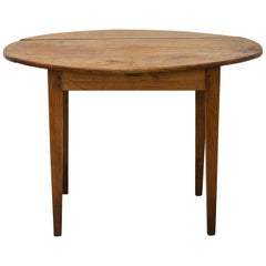 French Provincial Oval Solid Cherry Country Style Breakfast Table, circa 1830