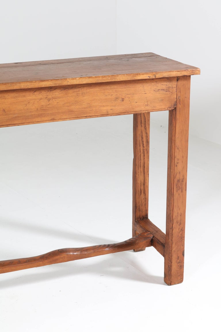 Stunning and rare French Provincial side-table or work table. Large size and manufactured circa 1890. Solid pine. In good original condition with minor wear consistent with age and use, preserving a beautiful patina.
