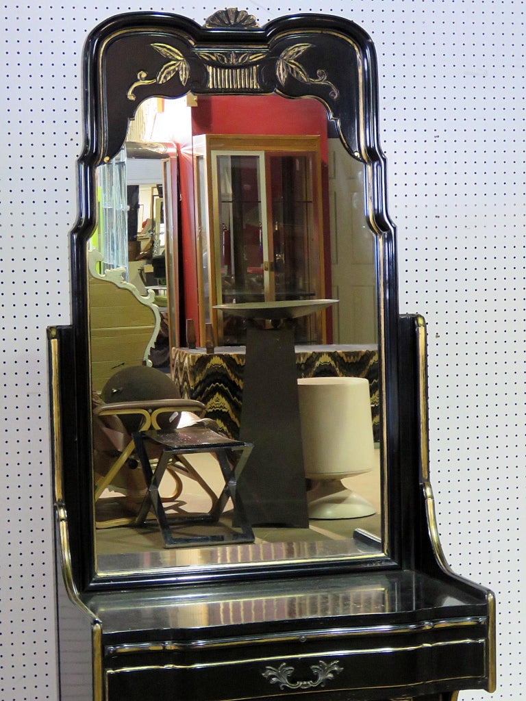Ruder French Provincial style ebonized vanity with gilt trim and a mirrored top with one drawer over two doors.