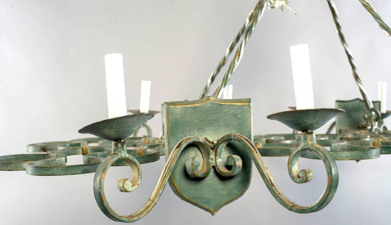 French Iron Chandelier Has Scroll Work Rectangular Base Suspended By Chain With Eight Candle Style Light