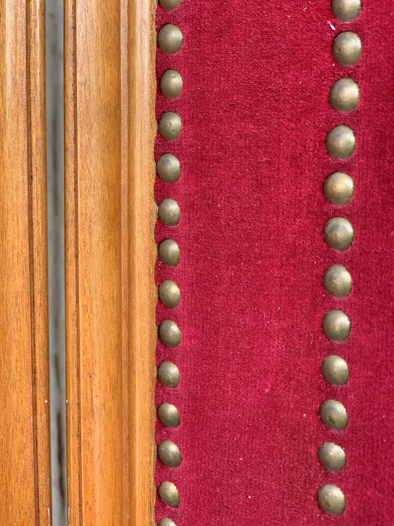 Hand-Carved French Red Velvet Three-Panel Screen Adorned with Antique Brass Tacks For Sale