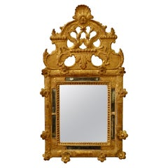 French Regence Period Giltwood Mirror with Birds, Scallop Shell and Flowers