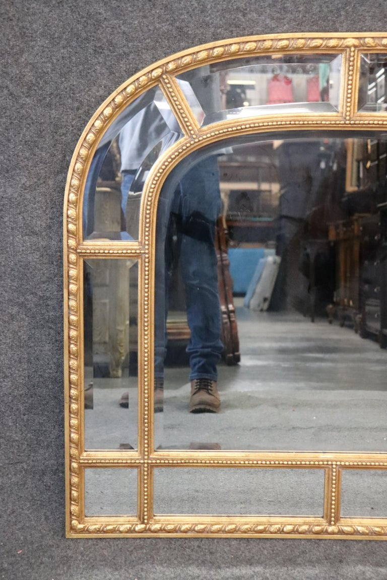 This is a beautiful gilded wood and gesso carved Decorative Arts mirror made in Italy for the famous New York firm. The mirror is perfect for a mantle or over a buffet. Measures: 39 tall x 41 wide x 1 deep.