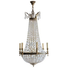 French Louis XVI Style Crystal Bronze Twelve-Light Chandelier