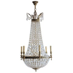 French Regency Style Cut Crystal Bronze Twelve-Light Chandelier