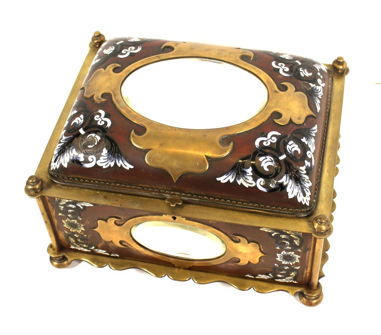 French Renaissance Revival champleve enamel jewelry box with oval beveled mirror inserts. Handmade in France during the mid-19th century. The piece has velvet interior lining and decorative floral enamel elements. In great antique condition with