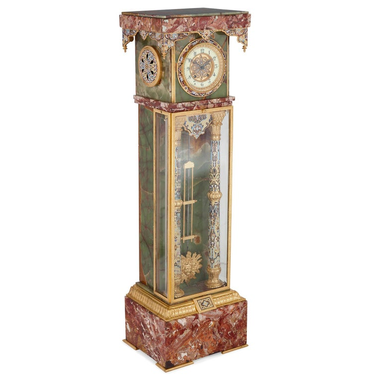 French Renaissance style gilt bronze and enamel mounted onyx standing clock French, late 19th century Height 126cm, width 36cm, depth 29cm  This colorful longcase clock was created in France in the late 19th Century. It has been crafted from red