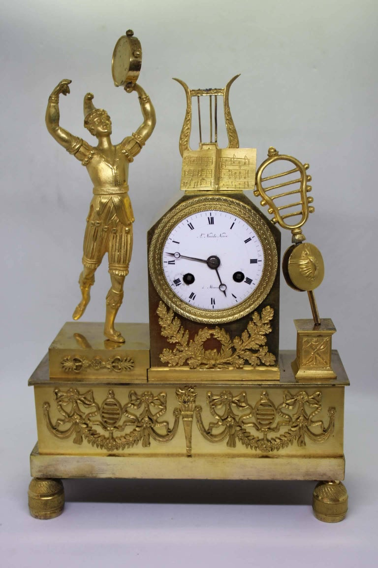 Gilt Bronze mantel clock representing allegory of music, from French Restauration period. 