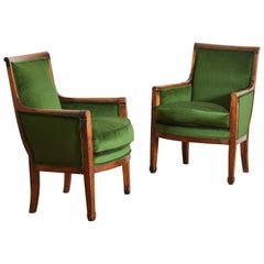 French Restauration Period Pair of Walnut and Upholstered Bergeres, circa 1825