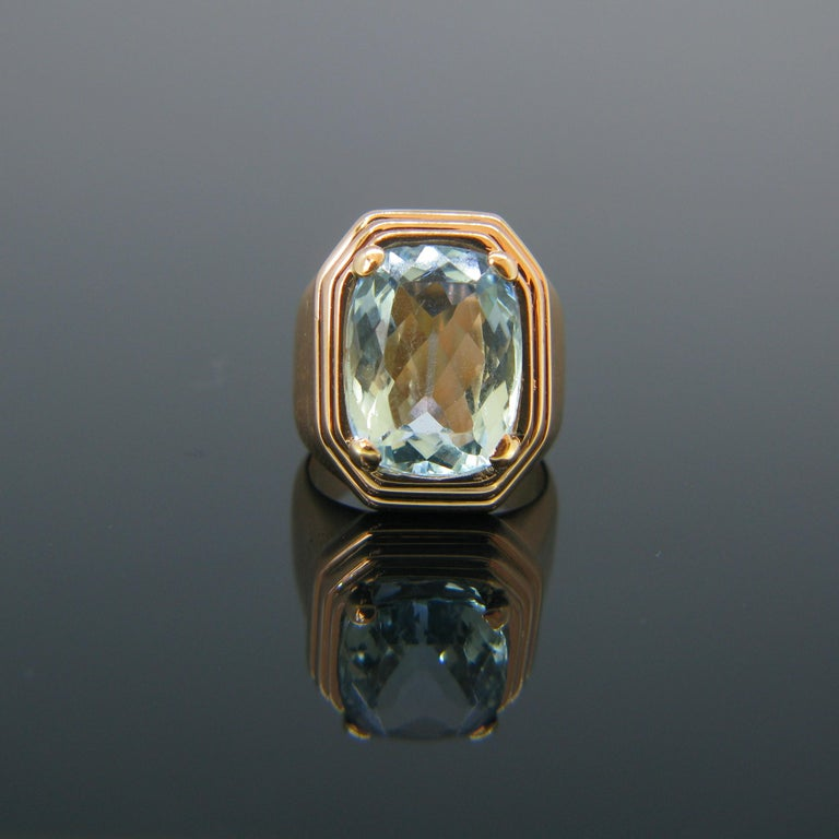 This amazing ring is set with a beautiful aquamarine of around 7.5ct. It is from the Retro era circa 1950s.  It is set in 18kt rose gold and marked with the eagle's head.   Circa:	Retro 1950s  Weight:	19.9gr  Metal:		18kt Rose Gold  Stones:	1