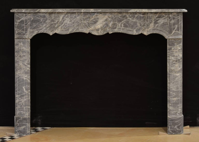 Beautifully grey marble Régence mantelpiece.