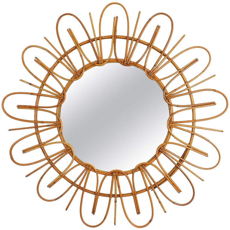 Lovely mid-20th century handcrafted rattan sunburst mirror. France, 1950-1960.