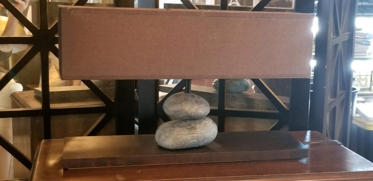Lovely French rock lamp from contemporary French Company. We sold a series of these and they remain popular for the unexpected element in any room. Hand cut shade and hand drilled stone elements.